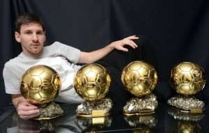 Jan 9, 2013; Barcelona, SPAIN; Lionel Messi poses with his four Ballon d'Or trophies aka golden ball trophies after winning the World Player accolade for a fourth straight year.  Mandatory Credit: Rondeau/Presse Sports via USA TODAY Sports